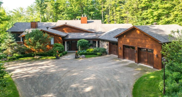 Modern and Sophisticated Log Mansion on a 41 Acres Lot in Lac-Brome