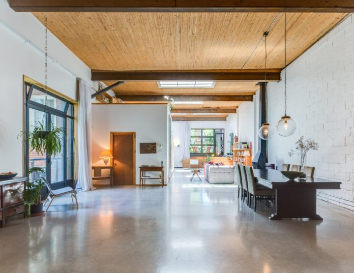14 Foot Ceilings, Skylights and Concrete Floors Make This Eclectic Rosemont Loft Unique