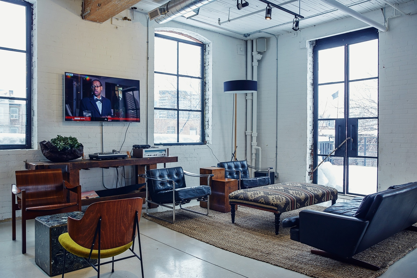Inside east room s hip coworking space in toronto via for Shared office space montreal