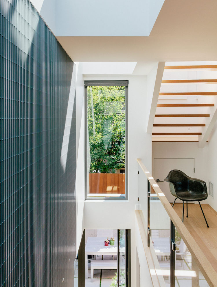 past-perfect-vancouver-multi-family-edwardian-home-renovation-kentwood-wood-floors-cascadia-windows-aluminum-bar-grating-eames-dax-chair