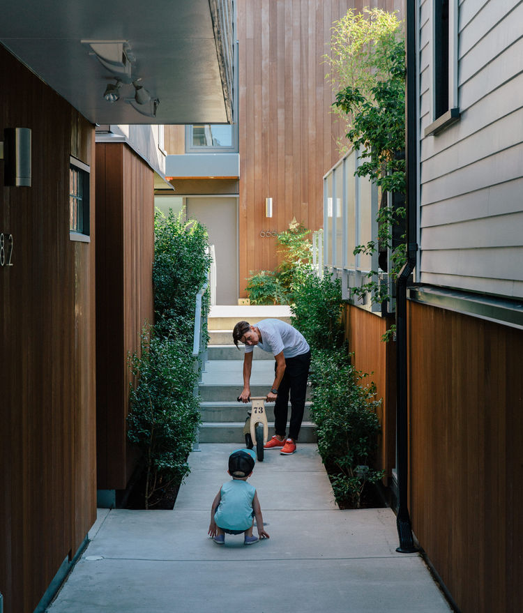 past-perfect-vancouver-multi-family-edwardian-home-renovation-walkway-stained-local-cedar-siding