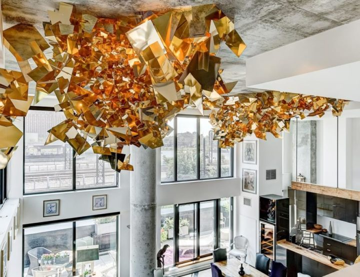 That's Gold! Corner Loft with 18' Ceilings Boasts Shiny Artwork